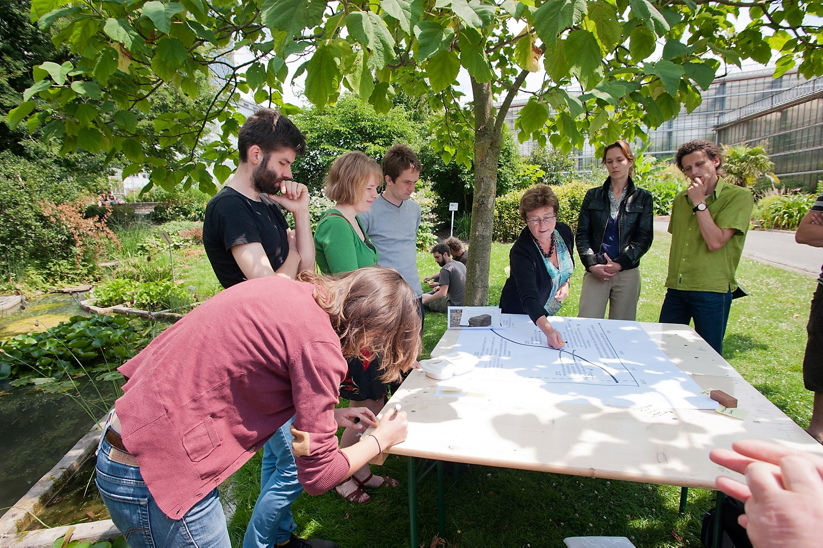 Universities can act as living laboratories where solutions to sustainability are implemented, researched and taught. In this case, students and staff are preparing plans for a sustainability garden on campus. (Photo: Green Office Ghent)